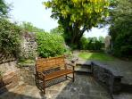 Private and secluded sunny rear garden with view to open countryside with two seating areas.