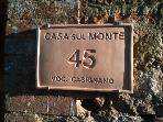 Casa sul Monte name plaque on front entrance