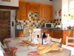 Open plan kitchen - gas cooker, microwave