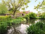 View of barn conversion/cottages from pond/BBQ area. Also see Hayloft and Threshing Barn photos
