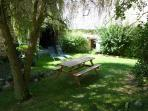 Your garden to sit and eat in the shade under the willow tree