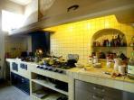 Giardini di Marzo- kitchen with fireplace