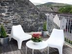 Rooftop terrace with views over the town and the hills beyond