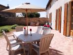 South facing terrace with sun loungers, table, chairs and BBQ