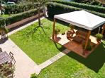 Private garden with table and BBQ