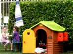 Children love the Wendy house, the sand pit and the swings as well as the ping pong table