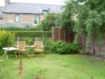 The garden, 25 yards from the cottage, is a real sun trap in the summer. BBQ is provided