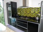 modern kitchen units with granite tops, drinking tap, elec over, gas hob, microwave, LED lights