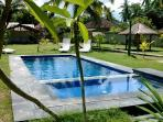 Swimming pool with childrens area in spacious garden perfect for relaxing after surf orexploring Kut