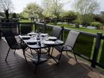 The lodge has a balcony with outdoor seating and BBQ area.