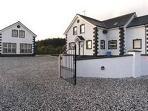 Private gated entrance with ample car parking
