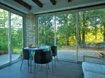 Guest lounge overlooking garden and woodland
