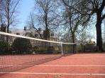 Synthetic grass tennis court
