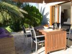 Terrace with diningtable with 4 chairs and parasol