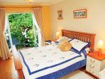 Master bedroom with garden access and en-suite shower room
