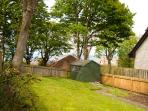 Private rear garden with views to Craigleith Island and the sea