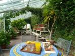 Furnished Glasshouse perfect for reading/relaxing in the walled garden