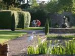 Walled garden with well stocked ponds, fountains, benches, tables and comfy chairs