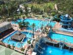 The water park with swimming pools, pool bar and water slides