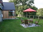 Rear of Stable Barn with lawned patio area