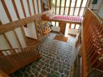 The beautiful galleried hall with handmade staircase leads up to the four bedrooms & family bathroom