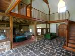 The hallway with original stone floor has the sitting room to the left & dining room to the right.