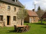 The Farmhouse from the central courtyard showing bakehouse where bikes are stored for guest use