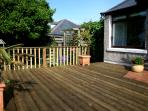 Spacious decking to eat, socialise and relax