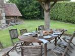 Table and chairs in the communal al fresco eating area - BBQs are available for all to use.