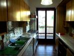 kitchen with owen washing and dishing machine gas frigo ( with a bottle of wine for you ) equipped w