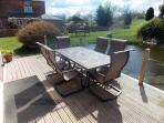 Decking area overlooking duck pond, with barbeque facility, with Slate topped table