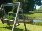 Swing chair overlooking the duck pond