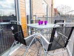 Alfresco dining on the sunny, south facing balcony.