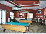The games room with pool table, air hockey table, darts, gaming machines, TV   Etc