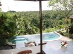 View from the generous size balcony of the Bungalow next to the swimming pool