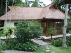 The bungalow from the garden. It has one bedroom with en-souite bathroom and terrace.