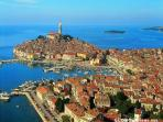 The romantic Venetian  town of Rovinj with its pastel painted waterfront façades is just 20km away
