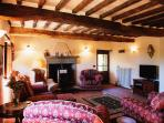 Main sitting room with original features, comfortable seating,TV plus DVD collection and guide books