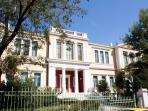 Stunning view to the neoclassical building of Maraslios school, surrounded by trees.