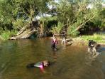 Playing in the Bowmont river between Town and Kirk Yetholm