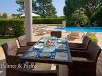 Outdoor dining terrace with barbecue