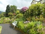 A lovely place to sit and enjoy the gardens at Lyn Holiday Apartments