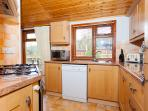 Modern kitchen with dishwasher and fridge freezer