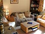 The comfortable openplan Lounge with cosy Welsh Blankets,TV DVD  and CD player as well as Free Wi-FI
