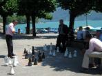 Locals playing outdoor chess by Lake Lugano - a day trip to Switzerland