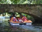 Pedal boats on the river at Pons - a citadel on the pilgrimage route to Compostello