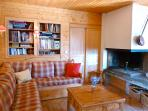 Lounge with corner sofa and open log fire