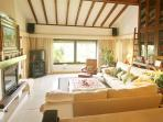 Vaulted lounge, fireplace, TV, DVD, Blu-Ray, Music System.