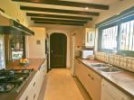 Fully fitted kitchen, fridge/freezer, dishwasher, electric oven, gas hob, microwave, kettle, toaster