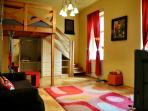 Large room with 2 beds for 4 persons to sleep
